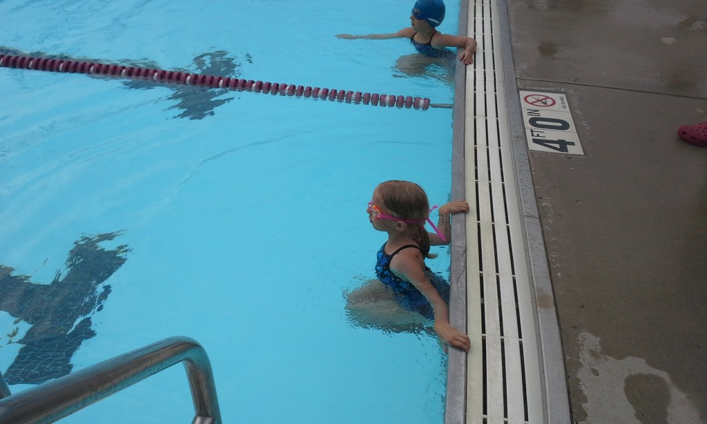 Emmy waits for the whistle to swim a 25 yard breaststroke.