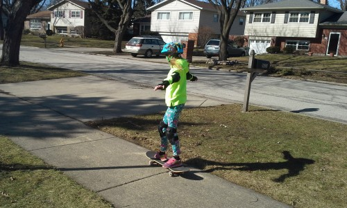 Lily skateboarding